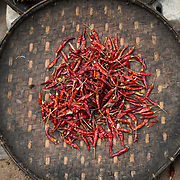 Dried red chili peppers on a bamboo platter on displace at the morning market at Myinkaba Village. Myinkaba Village, a small local village that lies between Old Bagan and New Bagan in Myanmar.