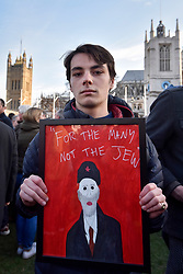 © Licensed to London News Pictures. 26/03/2018. LONDON, UK.  Members of the Jewish community gather in Parliament Square to protest against Jeremy Corbyn and the Labour party's failure to tackle anti-Semitism within the party.  A letter drawn up by the Board of Deputies of British Jews and the Jewish Leadership Council with this sentiment is to be delivered to a meeting of Labour MPs and peers ahead of their weekly meeting.  A counter-demonstration by pro-Corbyn Jewish Labour members is due to be staged nearby at the same time.  Photo credit: Stephen Chung/LNP