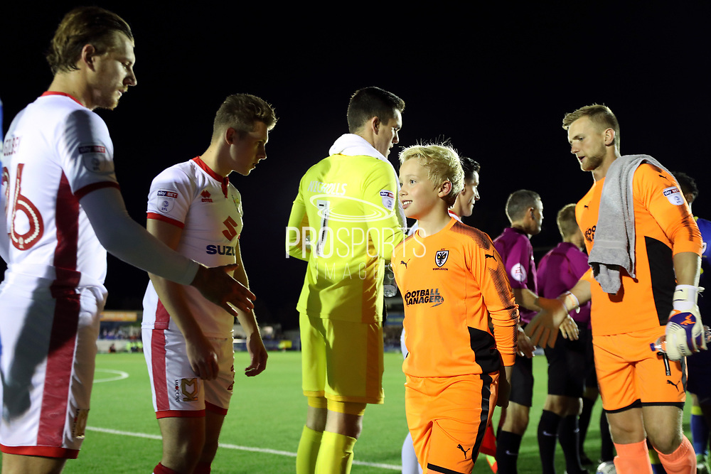 AFC Wimbledon mascot refusing to shake hands during the EFL Sky Bet League 1 match between AFC Wimbledon and Milton Keynes Dons at the Cherry Red Records Stadium, Kingston, England on 22 September 2017. Photo by Matthew Redman.