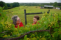 Backyard Road Farm & Vineyard's Deborah Price (left) tells Vance County extension agent Paul McKenzie about her current crop at her farm outside Henderson.
