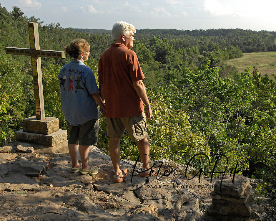 Directv Magazine -- Camp Barnabas founders Cyndy and Paul Teas look out over the southwestern Missouri hills from Inspiration point at Camp Barnabas.