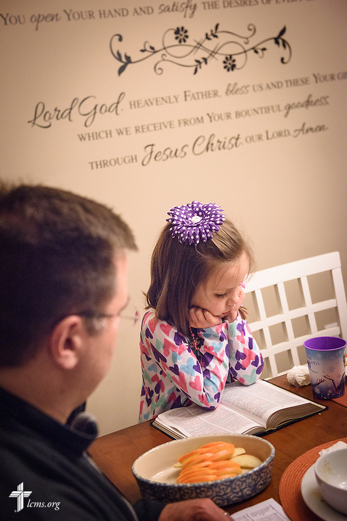 Michael Vogt has his daughter Elizabeth read from the Bible during an evening devotion with the Congregation at Prayer resource at their home on Sunday, Feb. 7, 2016, in Menomonee Falls, Wis. LCMS Communications/Erik M. Lunsford