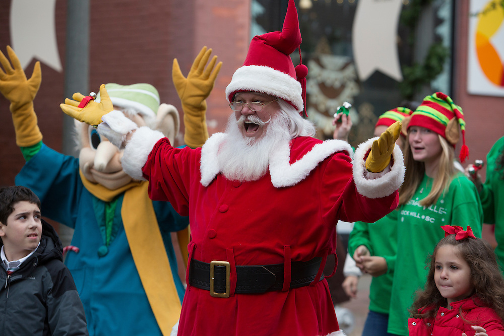 Children and adults enjoy Santa's Parade during Christmasville in Old Town.