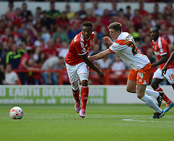 BlackPool's Charles Dunne ttys to hold back Nottingham Forest's Britt Assombalonga - Photo mandatory by-line: Alex James/JMP - Mobile: 07966 386802 09/08/2014 - SPORT - FOOTBALL - Nottingham - City Ground - Nottingham Forest v Blackpool - Sky Bet Championship - First game of the season