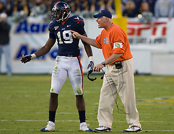 Virginia head coach Al Groh instructs his defense during the fourth quarter with Virginia cornerback Ras-I Dowling (19) next to him.  The Virginia Cavaliers defeated the #18 ranked Georgia Tech Yellow Jackets 24-17 in NCAA Division 1 Football at Bobby Dodd Stadium on the campus of Georgia Tech in Atlanta, GA on October 25, 2008.