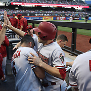 A.J. Pollock, Arizona Diamondbacks, is congratulated by team mates in the dugout after scoring a run in the first inning during the New York Mets Vs Arizona Diamondbacks MLB regular season baseball game at Citi Field, Queens, New York. USA. 10Th July 2015. Photo Tim Clayton