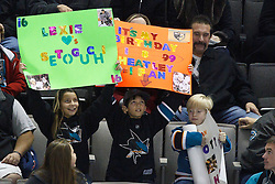 January 8, 2011; San Jose, CA, USA; San Jose Sharks fans hold up signs in support of right wing Devin Setoguchi (not pictured) and right wing Dany Heatley (not pictured) during the first period against the Nashville Predators at HP Pavilion. Nashville defeated San Jose 2-1. Mandatory Credit: Jason O. Watson / US PRESSWIRE