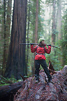 Young woman hiking in Humboldt Redwoods State Park, CA.