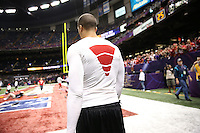 Colin Kaepernick (7) of the San Francisco 49ers warms up against the Baltimore Ravens during the NFL Super Bowl XLVII football game in New Orleans on Feb. 3, 2013. The Ravens won the game, 34-31.   (Photo by Jed Jacobsohn)