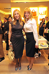 Left to right, AZRA HAYER and DR SHERRIE BAEHR at a Champagne & chocolate party hosted by Roger Vivier at their store in Sloane Street, London on 12th February 2009.  The evening was in aid of The Silver Lining charity.