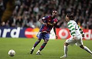 Yaya Toure beats Shunsuke Nakamura. Celtic v Barcelona, Uefa Champions League, Knockout phase, Celtic Park, Glasgow, Scotland. 20th February 2008.