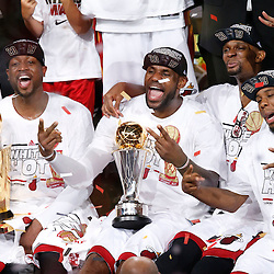 Jun 20, 2013; Miami, FL, USA; Miami Heat shooting guard Dwyane Wade (left), LeBron James (center) and Chris Bosh (right) celebrate after game seven in the 2013 NBA Finals at American Airlines Arena. Miami defeated the San Antonio Spurs 95-88 to win the NBA Championship. Mandatory Credit: Derick E. Hingle-USA TODAY Sports