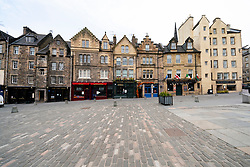 Edinburgh, Scotland, UK. 24 March, 2020.  Deserted streets in the heart of the Old Town tourist district in Edinburgh. All shops and restaurants are closed with very few people venturing outside following the Government imposed lockdown today. Pictured; View of an empty Grassmarket. Iain Masterton/Alamy Live News
