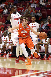 """21 November 2015: Asa Cantwell(3) cuts the baseline to get past Daouda """"David"""" Ndiaye (4). Illinois State Redbirds host the Houston Baptist Huskies at Redbird Arena in Normal Illinois (Photo by Alan Look)"""