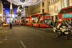 London, November 24 2017. Oxford Circus is sealed off after reports of an incident, creating havoc for traffic and underground commuters during Friday's rush hour, with police eventually standing down. Social media reports mentioned shots fired although this appears now not to be the case PICTURED: Buses, devoid of passengers wait for the police cordon to clear on Regent Street.. © Paul Davey