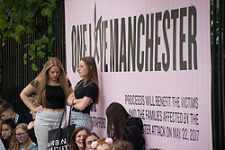 June 4, 2017 - Trafford, England, United Kingdom - People queue as people arrive for the One Love Manchester benefit concert at the Old Trafford cricket ground in Trafford, United Kingdom, Sunday, June 04, 2017. The One Love Benefit concert has been organised as tribute to the victims of the Manchester Arena attack at which Ariana Grande performed at the Manchester Arena on 05/22/2017. (Credit Image: © Jonathan Nicholson/NurPhoto via ZUMA Press)