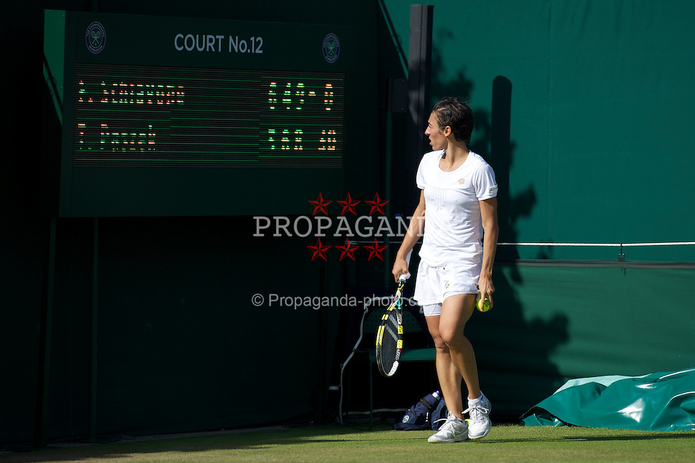 LONDON, ENGLAND - Saturday, June 25, 2011: Francesca Schiavone (ITA) looks at the scoreboard in the 38th game with the score 6-3, 4-6, 9-8 during the Ladies' Singles 3rd Round match on day six of the Wimbledon Lawn Tennis Championships at the All England Lawn Tennis and Croquet Club. (Pic by David Rawcliffe/Propaganda)