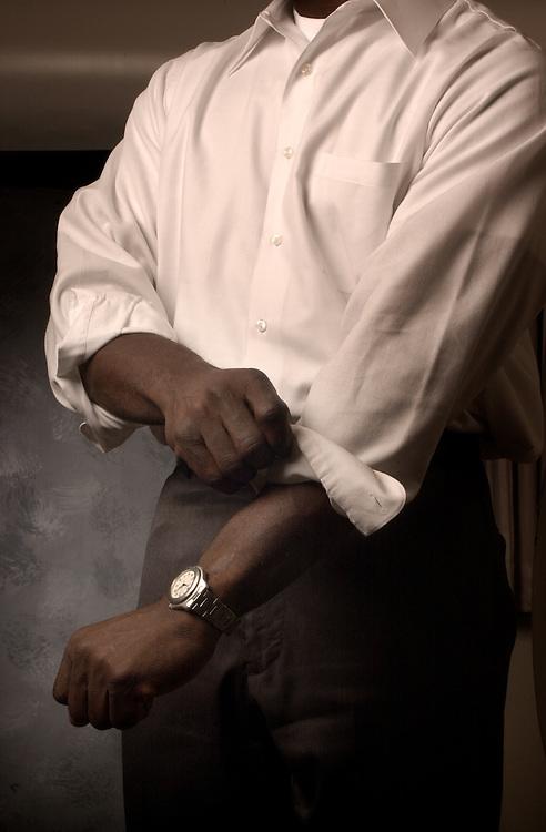 15103Ralph Amos Hands folding sleeve shot