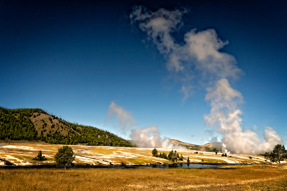 Yellowstone is where the beauty of the natural landscape merges with most amazing patches of thermal activities in the world.  This results in this white patches caused by certain bacterial growth.