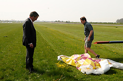 FILE PICTURE  © under license to London News Pictures. 01/12/2010 Pictured: Nigel Farage (L)  and Justin Adams (R) photographed a week before the flight which crashed. Justin Adams, the pilot of the plane which crashed and injured Nigel Farage has been charged with threatening to kill the politician. Picture credit should read Stephen Simpson/London News Pictures