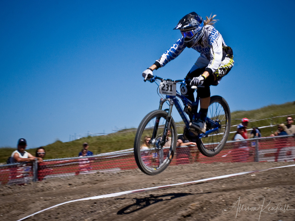 A female rider flies downhill at the SRAM Sea Otter Classic 2009 in Monterey California