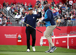 Europe's Martina Navratilova and John Regis celebrate during a celebrity golf match ahead of the 41st Ryder Cup at Hazeltine National Golf Club in Chaska, Minnesota, USA.
