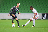 Melbourne City midfielder Nathaniel Atkinson (13) prevents the ball from going out at the FFA Cup quarter-final soccer match between Melbourne City FC and Western Sydney Wanderers FC at AAMI Park in Melbourne.