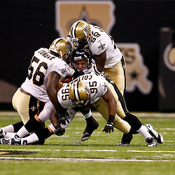 August 21, 2010; New Orleans, LA, USA; New Orleans Saints defenders Jo-Lonn Dunbar (56), Anthony Waters (59) and Harry Coleman (95) combine to tackle Houston Texans wide receiver David Anderson (89)during the second half of a 38-20 win by the New Orleans Saints over the Houston Texans during a preseason game at the Louisiana Superdome. Mandatory Credit: Derick E. Hingle