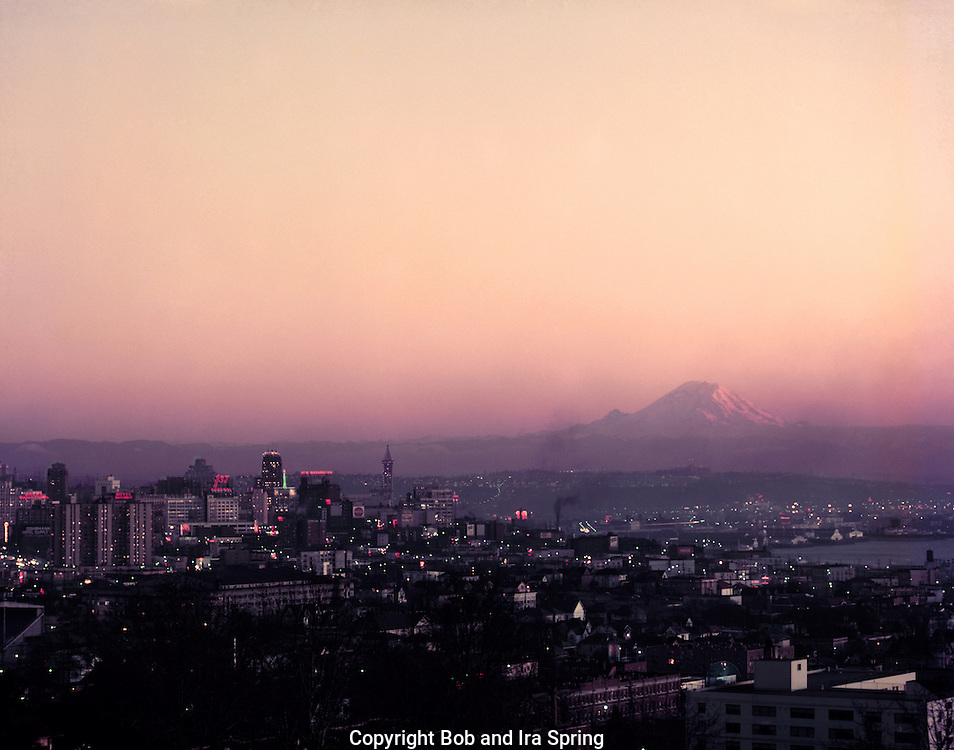 10073-02...WASHINGTON - A 1954 photograph of Seattle's skyline and Elliott Bay with Mount Rainier in the distance taken at sunset from Queen Anne Hill.