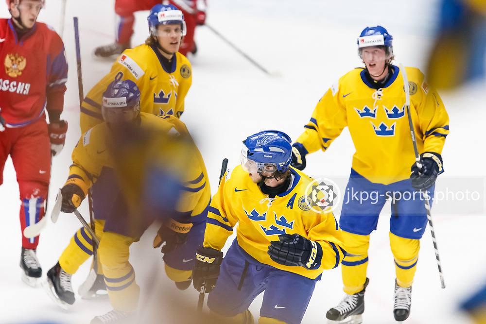 140104 Ishockey, JVM, Semifinal,  Sverige - Ryssland<br /> Icehockey, Junior World Cup, SF, Sweden - Russia.<br /> Team Sweden celebrates goal 1-0 by Filip Forsberg, (SWE).<br /> Endast f&ouml;r redaktionellt bruk.<br /> Editorial use only.<br /> &copy; Daniel Malmberg/Jkpg sports photo
