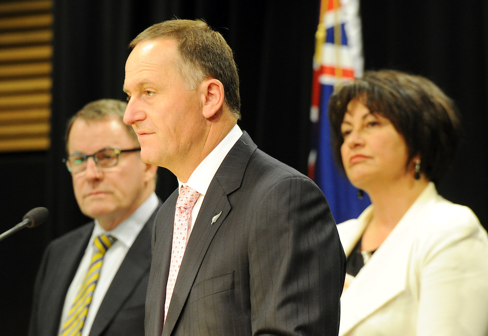 Prime Minister John Key, centre, with Associate Education Minister, ACT leader John Banks, left and Education Minister Hekia Parata at the announcement of the first five Partnership Schools, Parliament, Wellington, New Zealand, Tuesday, September 17, 2013. Credit:SNPA / Ross Setford