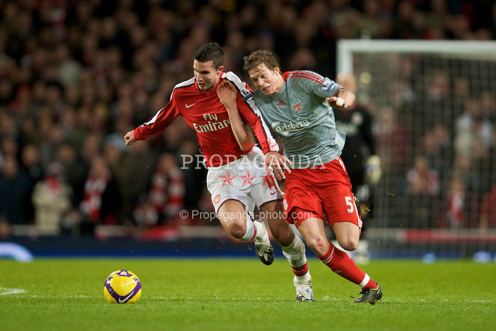 LONDON, ENGLAND - Sunday, December 21, 2008: Liverpool's Daniel Agger in action against Arsenal's Robin Van Persie during the Premiership match at the Emirates Stadium. (Photo by David Rawcliffe/Propaganda)