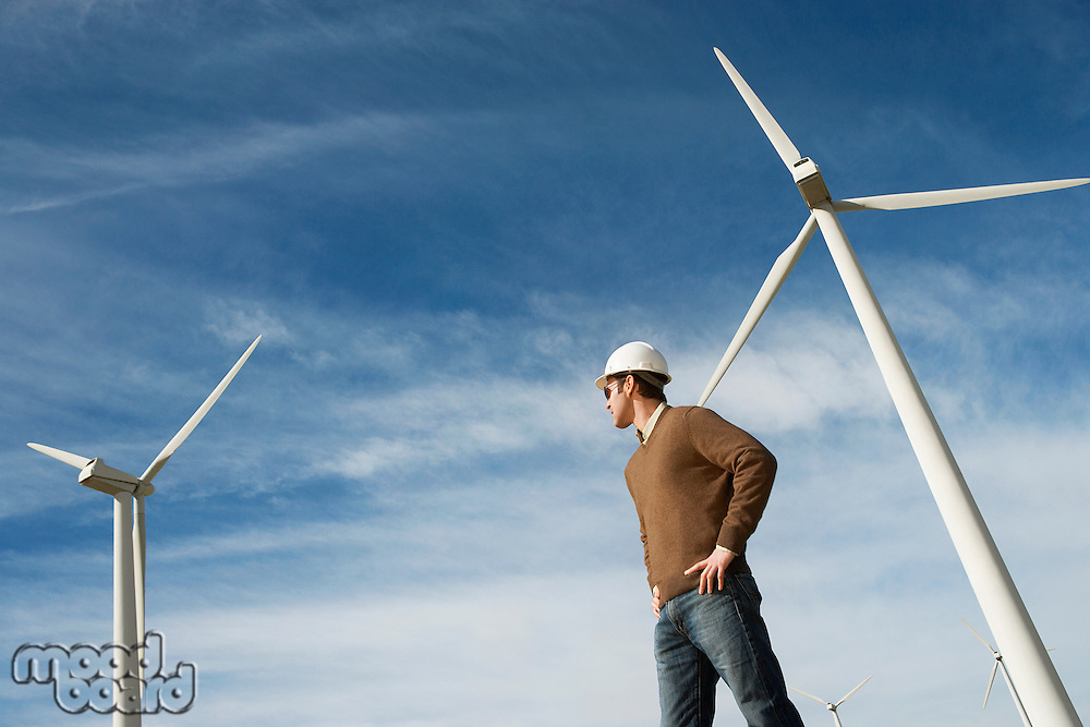 Engineer wearing hardhat at wind farm
