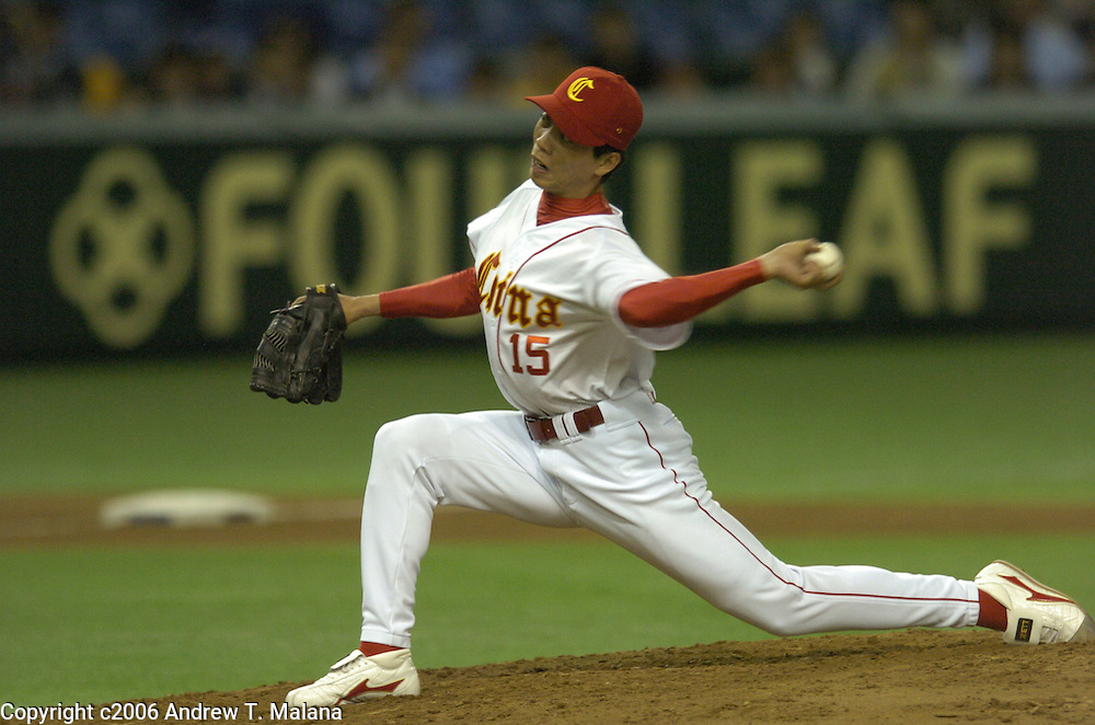 Team China relief pitcher Quansheng Zhao delivers a pitch in the 4th inning against Team Japan in the second game of the World Baseball Classic at Tokyo Dome, Tokyo, Japan.