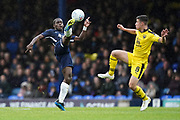 Dru Yearwood of Southend United high kick under pressure from Cameron Brannagan of Oxford United during the EFL Sky Bet League 1 match between Southend United and Oxford United at Roots Hall, Southend, England on 6 October 2018.