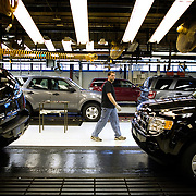 A worker checks the inspection line as President Bush tours the Ford Motor Company -- Kansas City Assembly Plant Tuesday, March 20, 2007, in Kansas City, MO.  Tour guides are Mayor Jim Stoufer; Alan Mulally, President and CEO of Ford Motor Company; Ken Ward, Plant Manager. <br /> <br /> Photo by Khue Bui