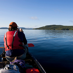 Canoeing in Lily Bay on Moosehead Lake Maine USA (MR)