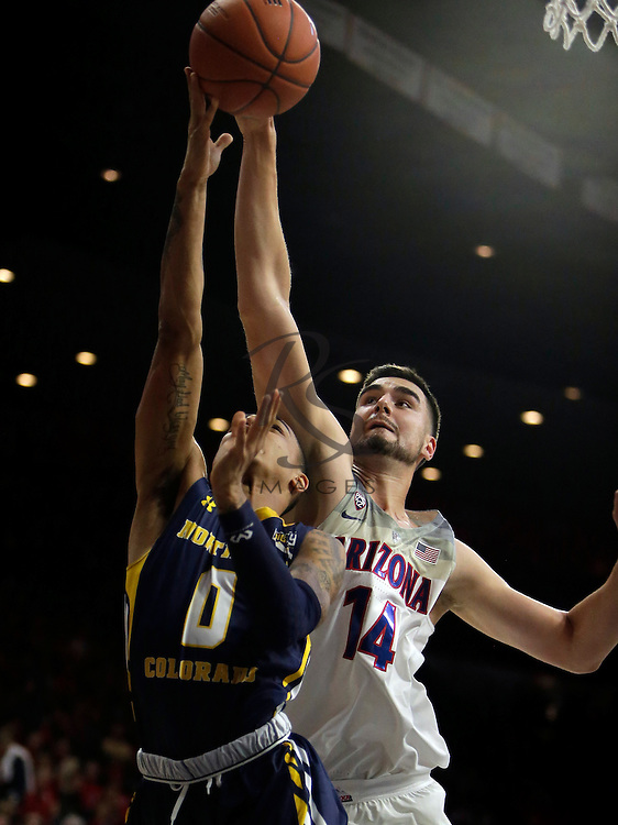 Arizona center Dusan Ristic (14) during the first half of an NCAA college basketball game against Northern Colorado, Monday, Nov. 21, 2016, in Tucson, Ariz. (AP Photo/Rick Scuteri)