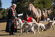Reverend Burt Keller performs the the annual Blessing of the Hounds beginning the start of the season on at Middleton Place Plantation November 25, 2012 in Charleston, South Carolina. Fox Hunting in South Carolina is a drag hunt which doesn't kill live foxes.