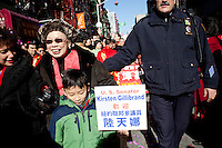 1 February, 2009. New York, NY. A boy holds a sign of United States Kirsten Gillibran that iis 15 feet behind him. New York Senator Kirsten Gillibrand is here on Mott street in Chinatown for the 10th Annual Chinatown Lunar New Year Parade to give a speech in Mandarin.  Sen. Gillibrand learned the language after she spent a semester in China.<br /> <br /> ©2009 Gianni Cipriano for The New York Times<br /> cell. +1 646 465 2168 (USA)<br /> cell. +1 328 567 7923 (Italy)<br /> gianni@giannicipriano.com<br /> www.giannicipriano.com