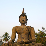 Buddha at Wat Mahathat in Sukhothai. The Sukhothai kingdom was an early Thai kingdom in north central Thailand. It existed from during the 13, 14, 15th centuries The.old capital is in ruins and is a Historical Park..View from Feb, 2007.