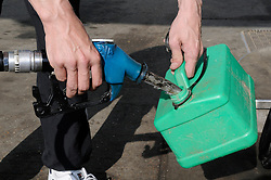 © Licensed to London News Pictures. 30/03/2012. Petrol Panic buying today 30.03.2012. Man filling a Jerry can at the BP garage on the A21 Lamberhurst Quarter, Kent. Photo credit : Grant Falvey/LNP