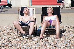 © Licensed to London News Pictures. 25/05/2014. Brighton, UK. People sunbathing on the beach. The May Bank Holiday Sunday has attracted thousands of people to visit the seaside resort and take to the beach. Photo credit : Hugo Michiels/LNP
