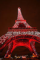 the Eiffel Tower lighted red for the visit of the Chinese President Hu Jintao..February 2004