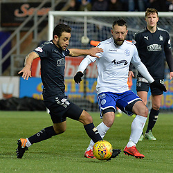 Tom Taiwo (Falkirk) and Stephen Dobbie (Queen of the South) during the Scottish Championship clash between Falkirk and Queen of the South at the Falkirk Stadium, where the home side pulled off a shock win.<br /> <br /> (c) Dave Johnston | sportPix.org.uk
