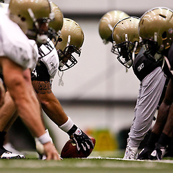 July 31, 2010; Metairie, LA, USA; New Orleans Saints center Jonathan Goodwin (76) prepares to snap the ball during a training camp practice at the New Orleans Saints indoor practice facility. Mandatory Credit: Derick E. Hingle