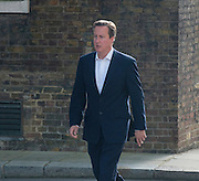 © Licensed to London News Pictures. 08/07/2014. Westminster, UK British Prime Minister David Cameron on Downing Street today 8th July 2014 after walking his daughter to Nursery. Photo credit : Stephen Simpson/LNP
