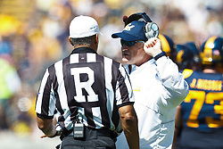 BERKELEY, CA - SEPTEMBER 08: California Golden Bears head coach Jeff Tedford talks to referee Michael Mothershed on the sidelines during the second quarter against the Southern Utah Thunderbirds at Memorial Coliseum on September 8, 2012 in Berkeley, California. The California Golden Bears defeated the Southern Utah Thunderbirds 50-31. (Photo by Jason O. Watson/Getty Images) *** Local Caption *** Jeff Tedford; Michael Mothershed