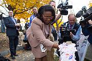 "Rochester Mayor Lovely Warren places her ""I Voted"" sticker on headstone of Susan B. Anthony, the social reformer who played a key part in the movement for women's suffrage, at Mount Hope Cemetery in Rochester on Tuesday, November 8, 2016. Warren is Rochester's first female mayor."