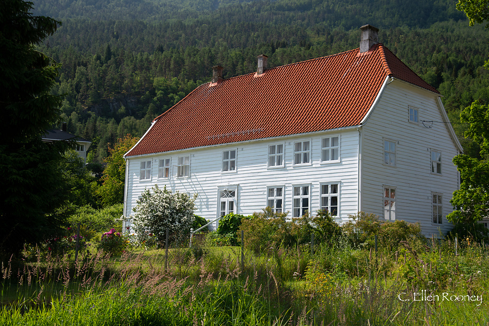 A traditional white painted wooden house in Solvorn, Lustra Fjord, Vestlandet, Norway